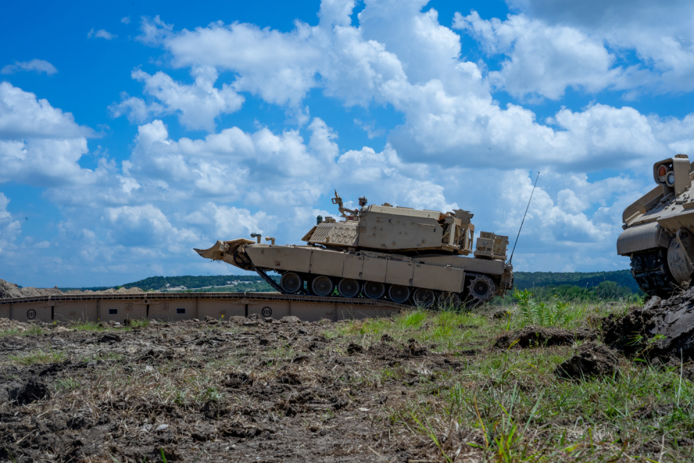 GREYWOLF Engineers with 3rd Brigade Engineer Battalion, 3rd Armored Brigade Combat Team, 1st Cavalry Division, roll across a Joint Assault Bridge (JAB) during a combined arms breach exercise, Fort Hood, Texas, June 6, 2021.
