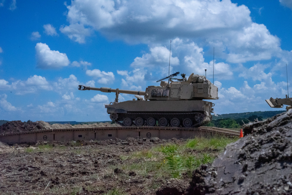 Cannoneers with 2nd Battalion, 82nd Field Artillery Regiment, 3rd Armored Brigade Combat Team, 1st Cavalry Division, trek over a Joint Assault Bridge (JAB) in their M109A7 Paladin during a combined arms breach exercise, Fort Hood, Texas, June 6, 2021.