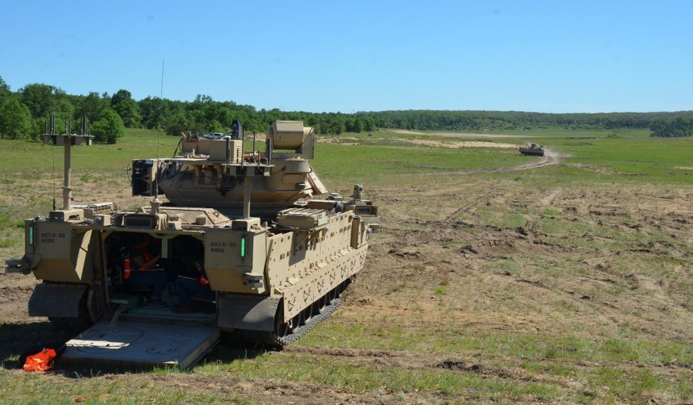 U.S. Army engineers and technicians at Camp Grayling Joint Maneuver Training Center, Grayling, Michigan, are testing Robotic Combat Vehicles equipped with autonomous software so they can be operated from a distance.