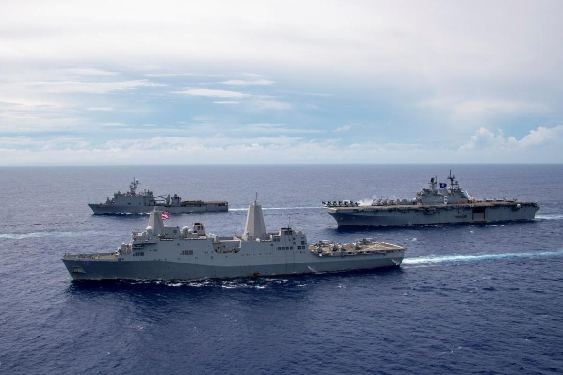 The America Amphibious Ready Group (ARG) sail in formation. Clockwise from right: USS America (LHA 6), USS New Orleans (LPD 18), USS Germantown (LSD 42).