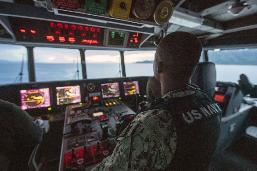 Chief Master-at-Arms Cornelius Johnson stands watch on the bridge aboard the Spearhead-class expeditionary fast transport USNS City of Bismarck (T-EPF-9).