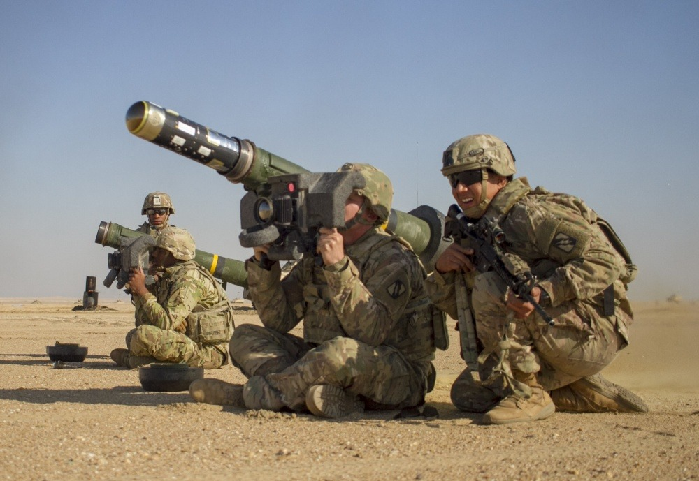 U.S. Army Pvt. Hayden Johnson, center, a cavalry scout assigned to Mississippi Army National Guard fires a Javelin shoulder-fired anti-tank missile during a combined arms live fire exercise as part of Desert Observer II the Udairi Range Complex near Camp Buehring, Kuwait.