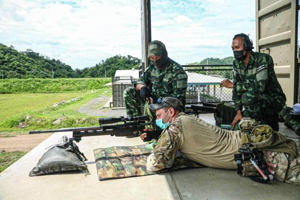 A Green Beret with 3rd Battalion, 1st Special Forces Group (Airborne), demonstrates long-range marksmanship techniques to soldiers with the Royal Thai Army as part of Cobra Gold 21 at Camp Erawan, Lopburi, Kingdom of Thailand, Aug. 5, 2021.