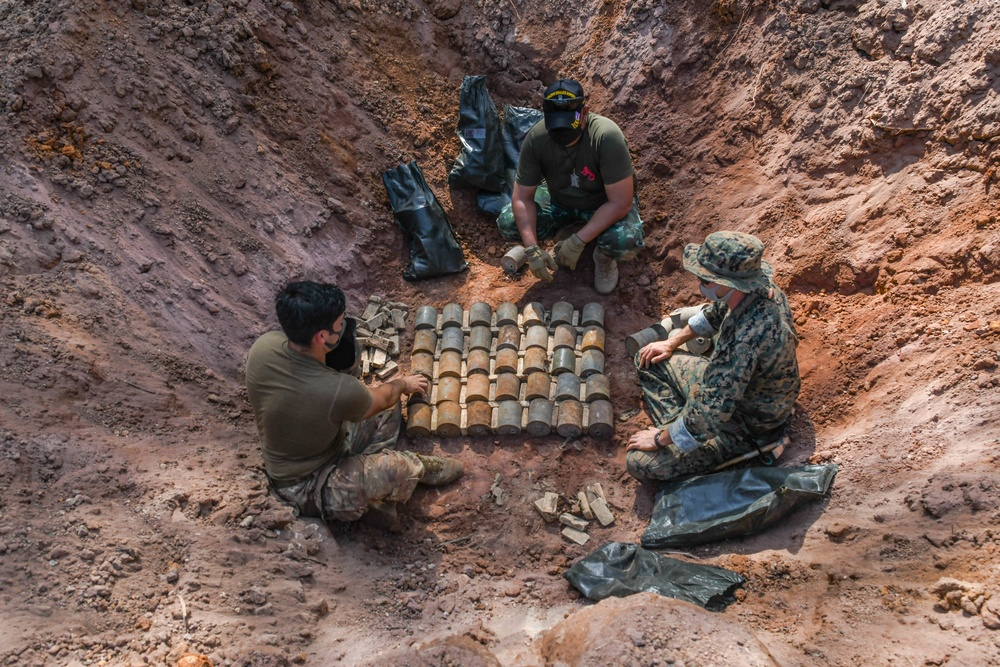 U.S. Air Force explosive ordnance disposal (EOD) technician with 18th Civil Engineer Squadron and U.S. Marine Corps EOD Technician place M16 and PMD landmines for large scale detonation during Exercise Cobra Gold 21 at Ta Mor Roi training area in Surin Province, Thailand, August 7, 2021.