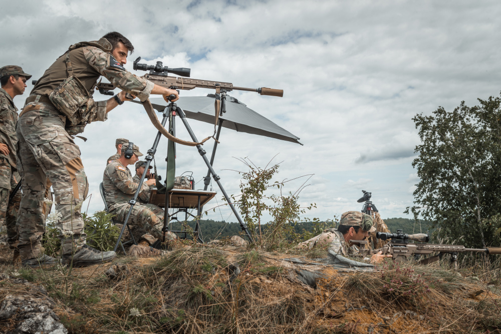 Greek soldiers search and engage targets during European Best Sniper Team Competition at Hohenfels, Germany, Aug. 11, 2021.
