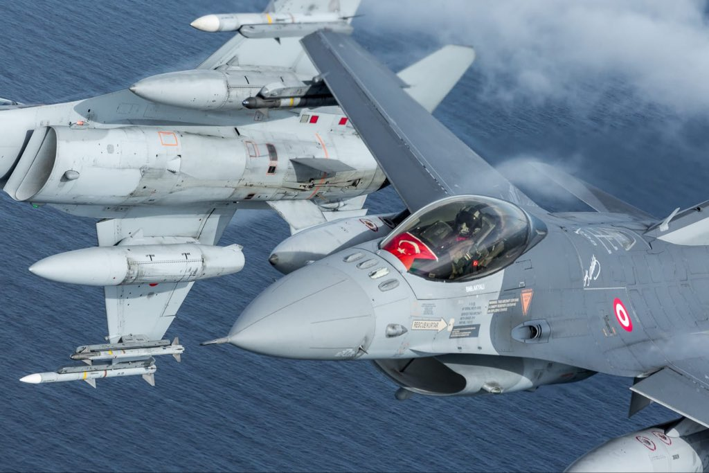 Turkish F-16 Fighter and Polish C-295M Aircraft Conduct Combined Flying Drills
