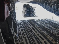 A standard cargo airdrop of the Palletized Munition Deployment System from a C-17A. A 4-pack configuration is used for demonstration purposes.