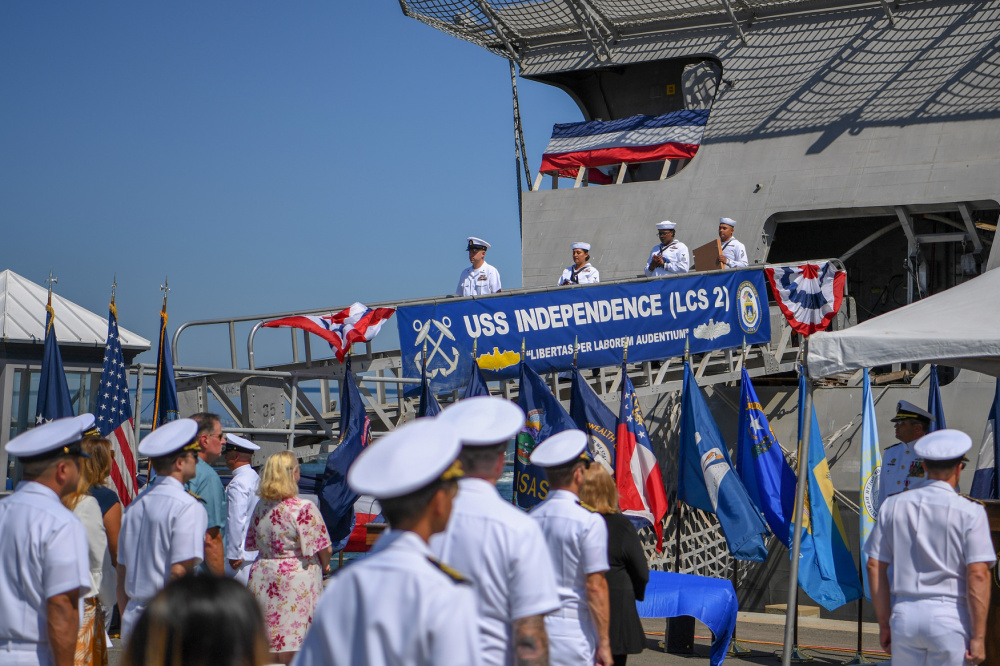 Ship's crew deliver the ensign and commissioning pennant during the decommissioning ceremony of littoral combat ship USS Independence (LCS 2). Independence was decommissioned after more than 10 years of distinguished service.
