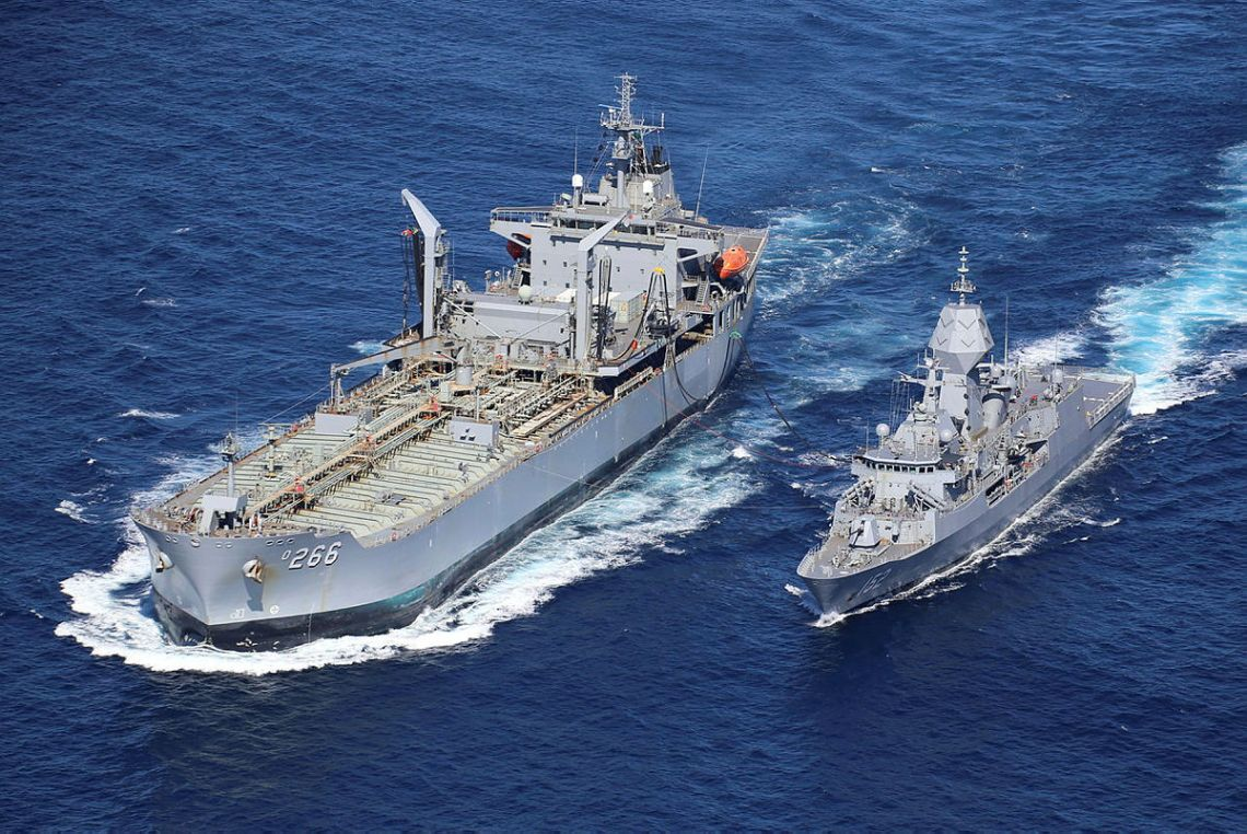 HMAS Warramunga conducts a Replenishment at Sea with HMAS Sirius prior to departing Australian waters to participate in Exercise MALABAR.