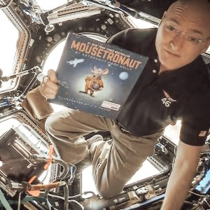 Astronaut Scott Kelly with Moustronaut book