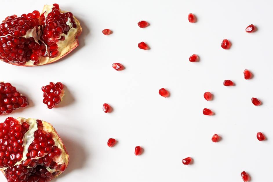 A pomegranate, with some arils spread out