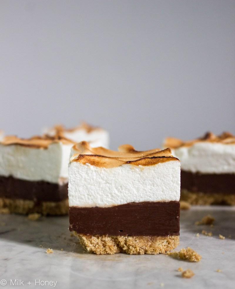 s'more fudge, Grahame cracker crust, chocolate fudge center, toasted marshmallow meringue.