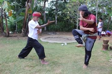 2 instructors teaching silat techniques