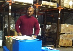 Kevin, the Milk Not Jails driver, preparing orders at our warehouse.