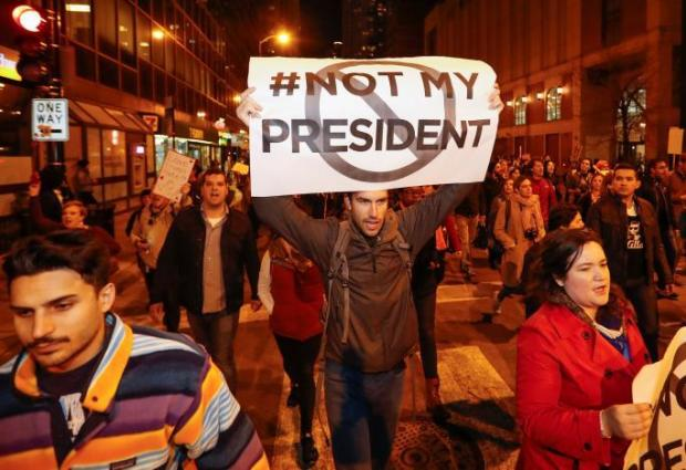 Protesters walk during a protest against Republican president-elect Donald Trump in Chicago, Illinois, U.S. November 9, 2016. REUTERS/Kamil Krzacznski