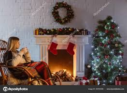 woman sitting in christmas decorate living room