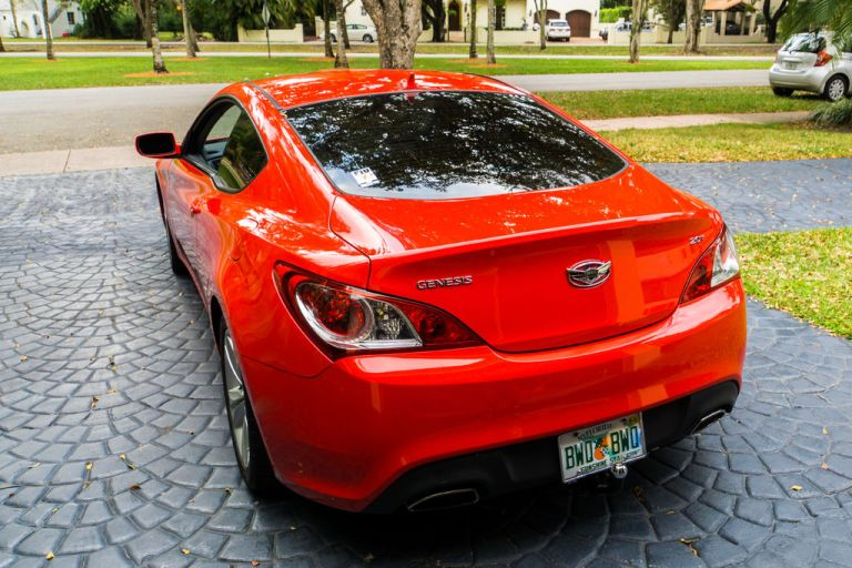 The first step of the Genesis Coupe rear spoiler install is to remove the trunk lining.