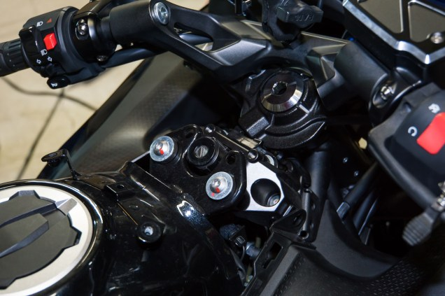 The job is a lot easier if you take off the motorcycle's ignition key fairing first. Luckily, it's just four allen bolts.