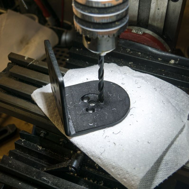 """Reuse the centered hole. Drill to the right size for the bolt (just over 1/4"""", so 17/64"""")."""
