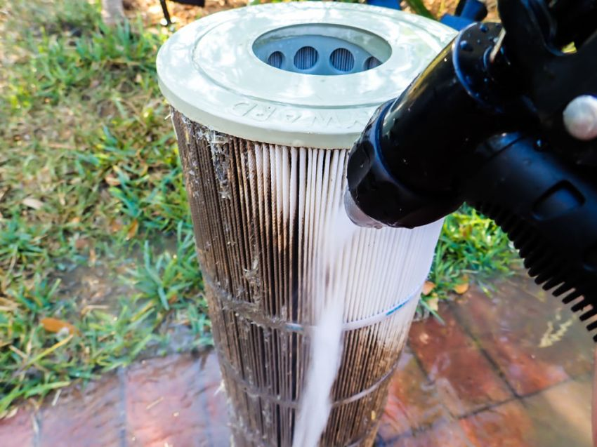 "The first step is to flush all the gunk out with water. There's no need to use one of those fancy ""filter cleaning tools"" (unless you already have one). Any hose nozzle will do, though some patterns are better than others. Remember to use moderate water pressure and maintain a 45 degree angle. DO NOT use a pressure washer."