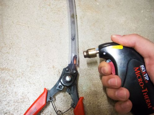 You might wanna apply heat and use some expanding pliers to get the tube on the fitting if it's tight.