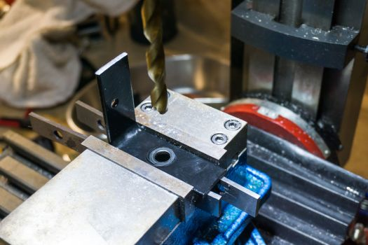Drill the hole which is centered on the bracket up to 10mm.