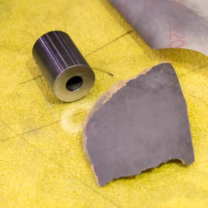 You'll want to use sandpaper with a grit between 200 and 1000.