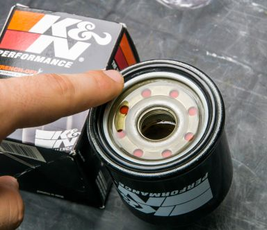 Lubricate the gasket on the oil filter with some oil to help it seal better.