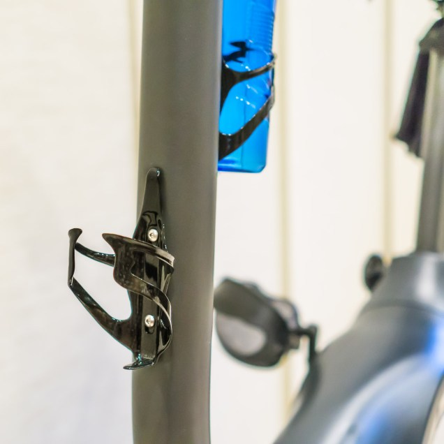The frame is thick enough to tap directly, so adding the extra bottle cage takes only a minute.