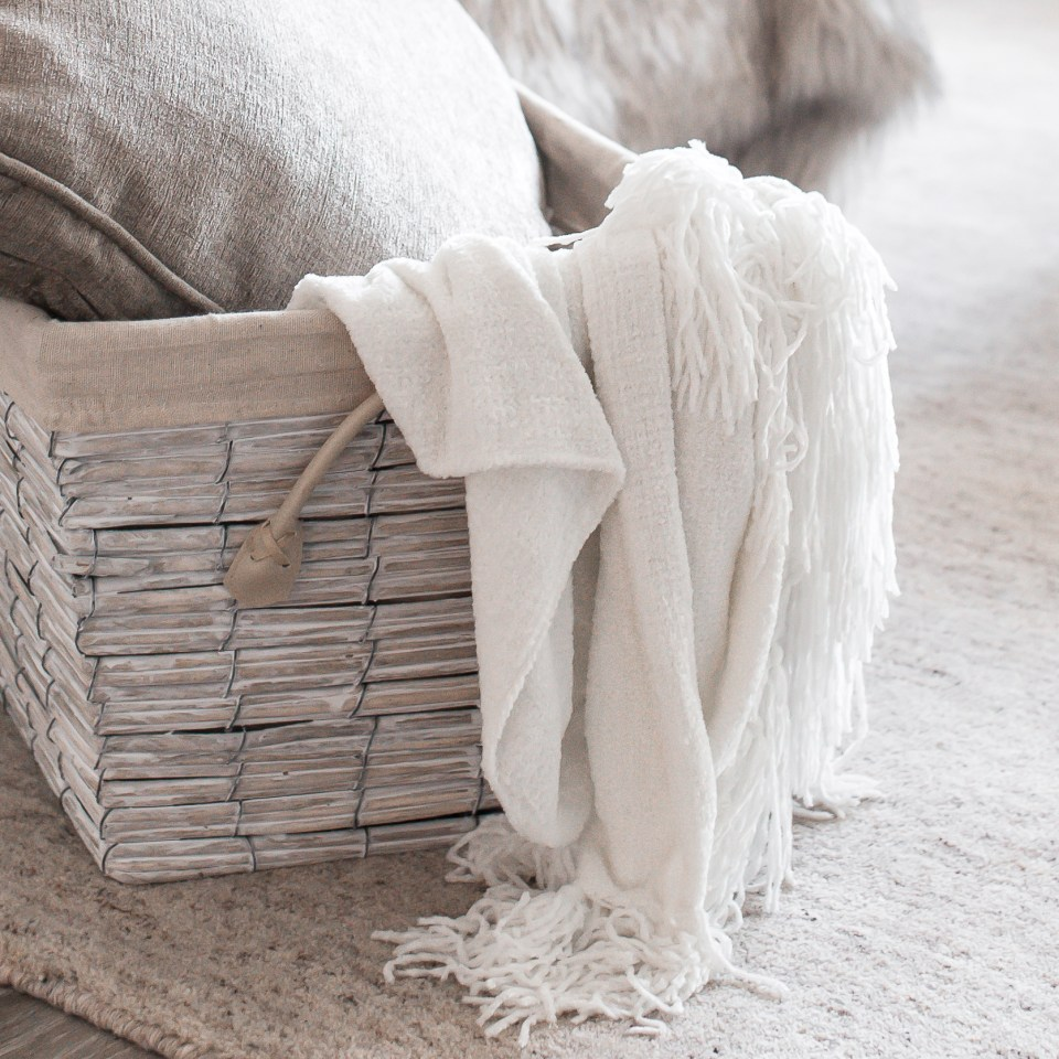 Neutral home interior with blanket and basket