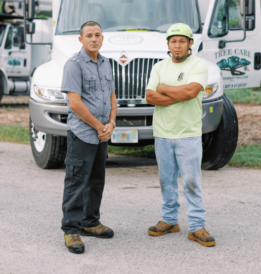 Tree Care by Robert Miller Foremen stand in front of work truck