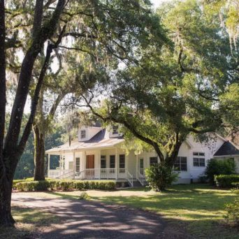 Home surrounded by trees | Emergency Tree Service