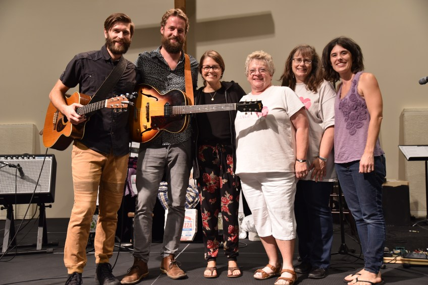 Group photo of musicians & organiers celebrating after the 2018 Benefit Concert