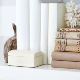 White interiors - www.myLusciousLife.com via www.styleathome.com books stacked