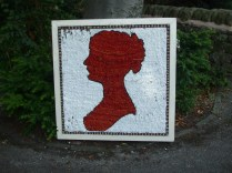 Jane Austen in the design of an old 'Penny Red' postage stamp.