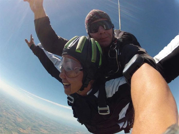 Image of senior woman tandem skydiving