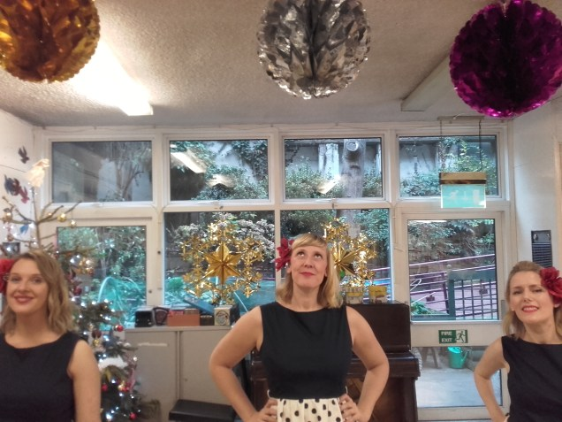 Ruby, Stac and Heather 'neath the Christmas baubles...