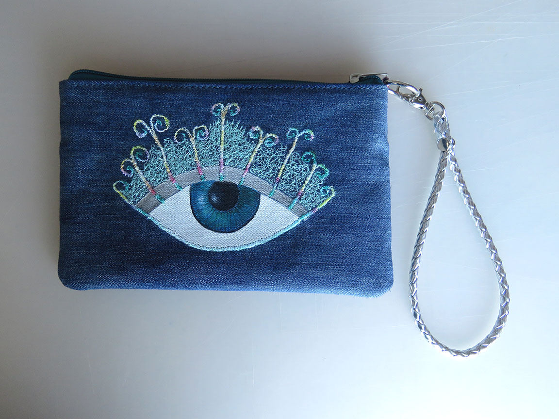 Denim purse with eye design
