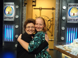 "Winner of the ""Play It Again"" $1,000,000 Giveaway!  Judith M. Powell and her daughter share a hug after her big win!"