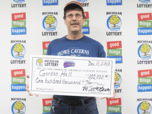 Gordon Hall of Portage claims $100,000  from the Michigan Lottery's $100,000 Cashword Instant game. (Photo Courtesy of the Michigan Lottery.)