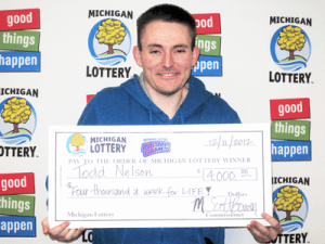Todd Nelson of Hale claims $4,000 a week for Life from the Michigan Lottery's $10 Cash for Life Instant game. (Photo Courtesy of the Michigan Lottery.)