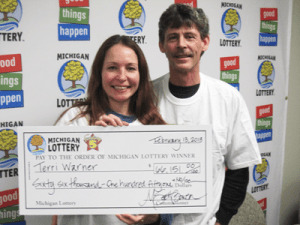 Terri Warner of Auburn Hills and her fiance Randy smile about the $66,151 Fantasy 5 win!