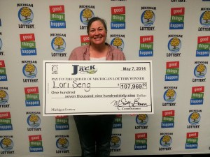 Lori Seng of Muskegon, poses with her big check for $107,969 from the Club Keno - The Jack drawing on May 3, 2014.