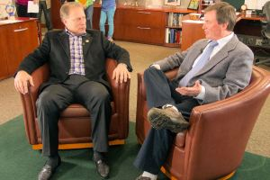 Donald P. Heeke (right) talks with Michigan State University basketball coach Tom Izzo prior to accepting his Excellence in Education Award from the Michigan Lottery.