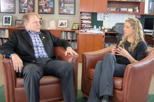 Amy Watts (right) talks with Michigan State University basketball coach Tom Izzo prior to accepting her Excellence in Education Award from the Michigan Lottery.