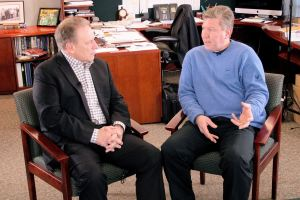 Michael Craig talks with Michigan State University basketball coach, Tom Izzo, prior to accepting his Excellence in Education Award from the Michigan Lottery.