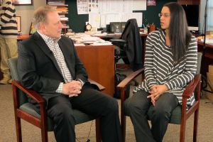 Sharon Spencer talks with Michigan State University basketball coach, Tom Izzo, prior to accepting her Excellence in Education Award from the Michigan Lottery.