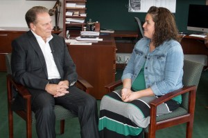 Jessica Day talks with Michigan State University basketball coach, Tom Izzo, after accepting her Excellence in Education award.