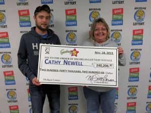 Cathy Newell poses for a photo with her son, Justin, after collecting a $240,206 Fantasy 5 jackpot at Lottery headquarters.
