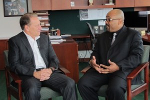 Dr. Jeffery D. Robinson talks with Michigan State University basketball coach, Tom Izzo, after accepting his Excellence in Education award.